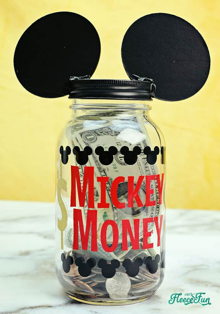 I love this Saving for Disney DIY Disney Savings Jar. Such a cute Mickey craft makes it fun for kids (and adults) to save for a Disney trip!. Easy craft that comes together quickly.