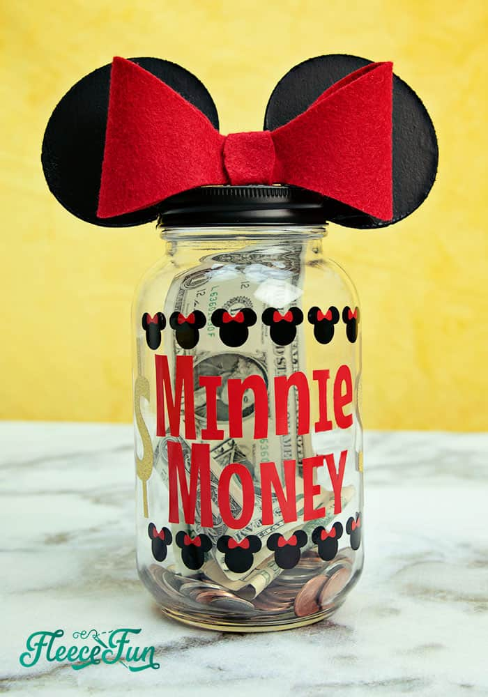 I love this Saving for Disney DIY Disney Savings Jar. Such a cute Mickey craft makes it fun for kids (and adults) to save for a Disney trip!. Easy craft that comes together quickly. #craft #cricut #disney #disneycraft