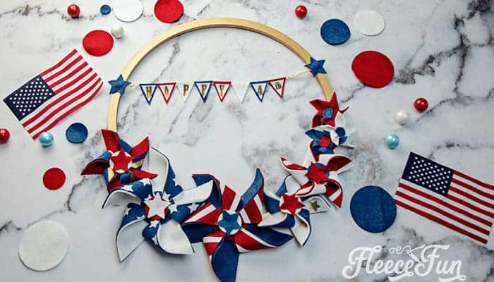 Make this Americana Decor DIY Patriotic Pinwheel Wreath. Download the FREE project file and follow the beautiful step by step photos and instructions.