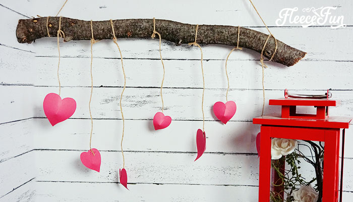 Perfect Valentine Decoration Ideas. This rustic heart branch is beautiful, simple and the step by step DIY comes with a free SVG cut file! #valentinedecorationsideas #valentinesdaydoordecorations #valentinesdoordecor #valentinesDIY #valentinesdaydiy #valentinesdayhomedecor #cricut #freesvg #freecutfile