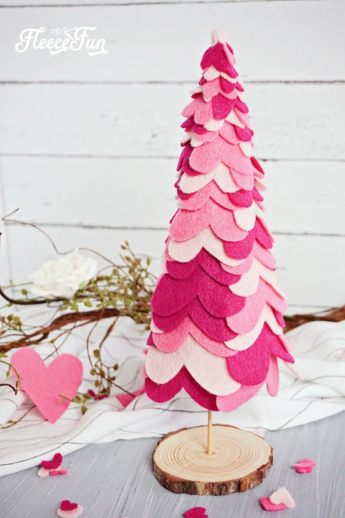 These adorable Valentine's Day Table Decorations are the perfect centerpiece to a lovely day. Made with felt hearts, you can make this adorable Heart tree in no time. Make several with different dowel lengths for interest. While I stayed in the pink family for the tree you can mix the colors to suit your own style and Valentines Day Décor. #valentinesday #valentinedecorationsideas #valentinesdaytabledecorations #valentinescenterpiece #valentinesDIY #valentinesdaydiy #valentinesdayhomedecor