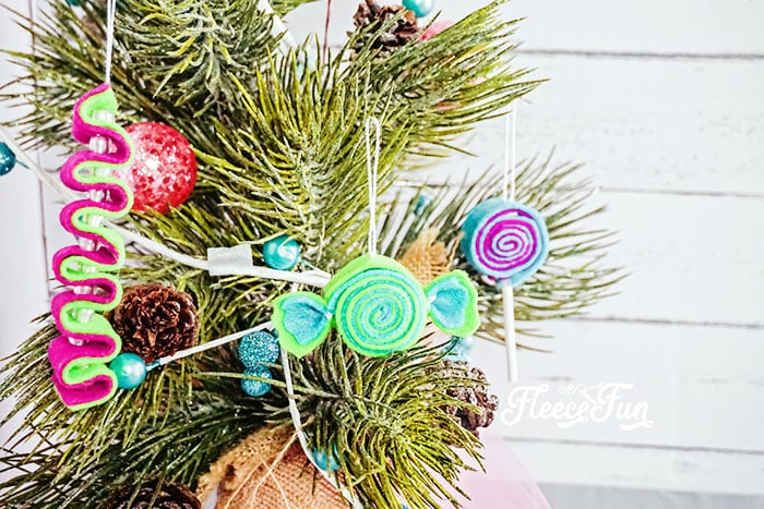 I love the look of these DIY Felt Candy Christmas Tree Ornaments.   Fast to make, they add a little whimsy and fun to your tree - while not adding calories to your waistline.