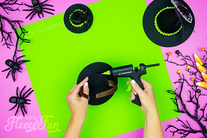 adding the headband and circle to the witch hat. This DIY Mini Witch Hat is no sew and comes with a free PDF pattern and SVG template to make it a breeze! 3 mini sizes so you can make the perfect hat!