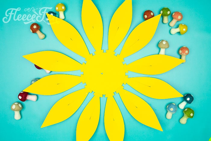 All petals glued into place. This Giant Paper Sunflower DIY (FREE SVG files) is perfect for fall! Make a Giant flower wall or use it to decorate your space! So many possibilities!