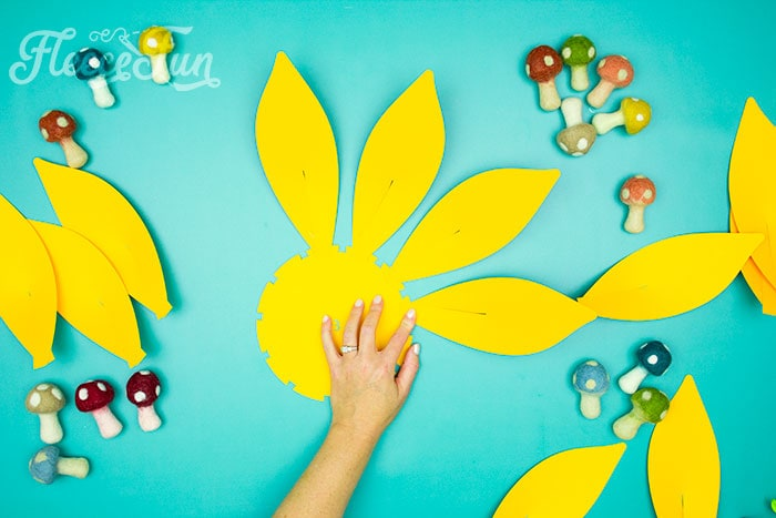 continue with next row. This Giant Paper Sunflower DIY (FREE SVG files) is perfect for fall! Make a Giant flower wall or use it to decorate your space! So many possibilities!