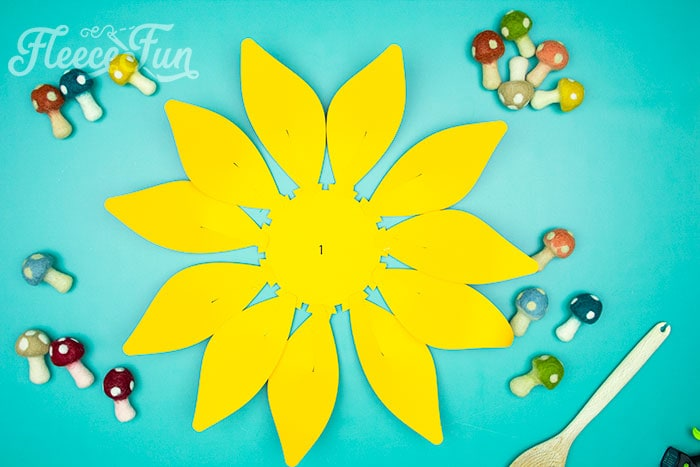 Firtst row of petals glued on . This Giant Paper Sunflower DIY (FREE SVG files) is perfect for fall! Make a Giant flower wall or use it to decorate your space! So many possibilities!