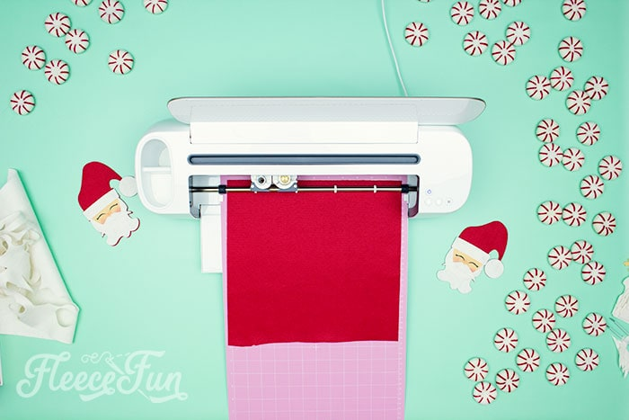 Cricut maker cutting the ornament. Items needed. With a Free Ornament Template you can make this adorable felt Santa! This homemade ornament is no sew and makes for a wonderful gift.