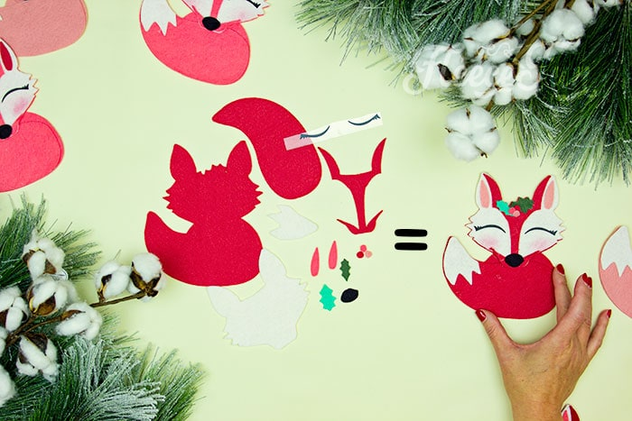 all of the elements that make up the free Christmas tree ornament pattern. This adorable Felt Fox Ornament DIY (Free Pattern) is a fun addition to your Christmas tree Ornaments! Curled up in it's tail with a bit of holly on it's head this fox is the embodiment of merriment. Use for tree decorations or as a fun addition to a wrapped gift. Also makes a wonderful hostess gift or prize at a holiday party. Perfect handmade ornament to make.