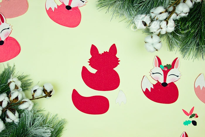beginning to put the ornament together. This adorable Felt Fox Ornament DIY (Free Pattern) is a fun addition to your Christmas tree Ornaments! Curled up in it's tail with a bit of holly on it's head this fox is the embodiment of merriment. Use for tree decorations or as a fun addition to a wrapped gift. Also makes a wonderful hostess gift or prize at a holiday party. Perfect handmade ornament to make.