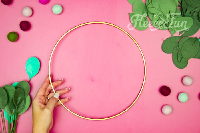 Gold wreath hoop. This modern Christmas Wreath DIY (made from felt) is a whimsical addition to your holiday décor. With a few items you can make this festive wreath. Because of the way it's constructed no two are alike. Make it as full or as thin as your taste's desire. Because it's made from felt, this wreath can be made in an array of colors to suit your style.