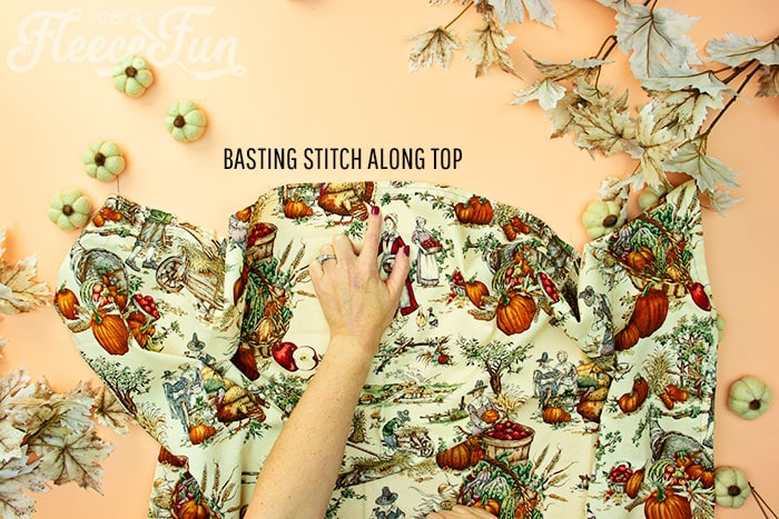 basting stitch along top of apron skirt. This Free apron pattern and tutorial includes a pdf pattern and video! Make a vintage style apron that is chic.