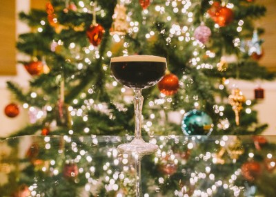 espresso martini in a cocktail glass by a Christmas tree shot by Lex Fleming Photo