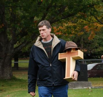 Mike bringing the cross-shaped urn into the Abercrombie Cemetery.