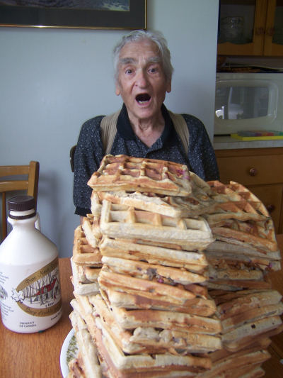 A pile of waffles and some maple syrup present a challenge