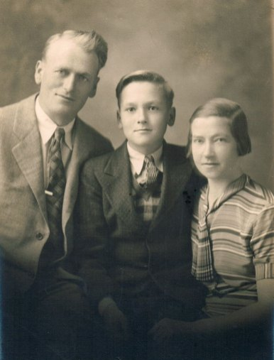 With his parents, mid-1930s