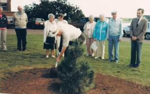 Planting a memorial tree for his father at the Tatamagouche Centre, 1989