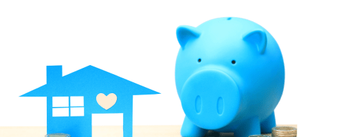 CUT OUT OF BLUE HOUSE BESIDE BLUE PIGGY BANK