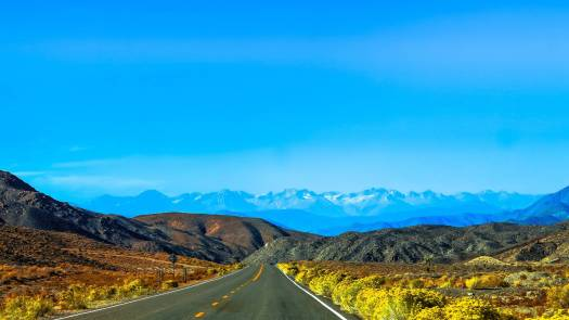 asphalt blue sky clouds countryside