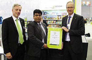 Sanjeev Kumar of Zircon received the first HD Screening certification from Carsten Knudsen of Esko with Jan Buchweitz of Esko to his right at drupa in Dusseldorf