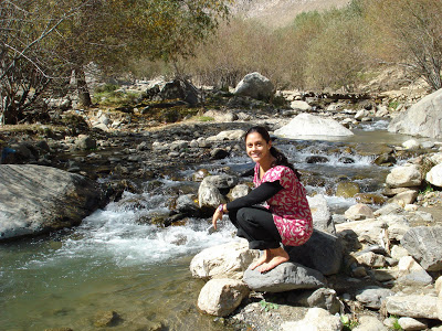No scarf, no shoes, no problem (!) at the Kabul River in Paghman Mountains.