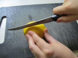 Cut a lemon into halves