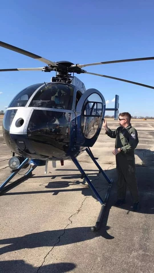 Officer Jason Sattich shows Flight Club's Intro to Aviation class LMPD's helicopter.
