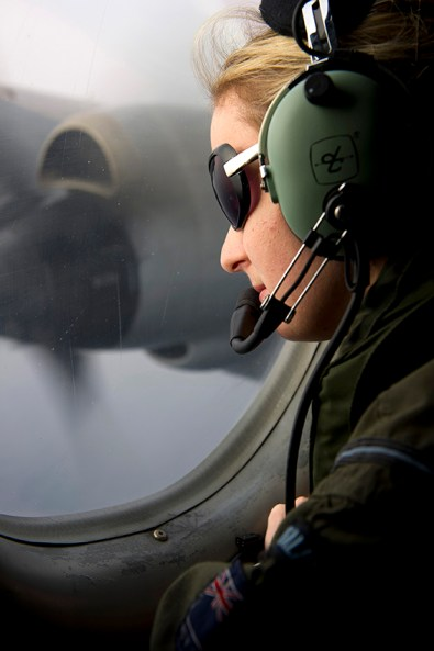 Royal New Zealand Air Force (RNZAF) Air Warfare Officer and Information Manager, Flying Officer Deborah Haines, scans the southern Indian Ocean in support of the Australian Maritime Safety Authority-led search for Malaysia Airlines MH370. Image: © Commonwealth of Australia, Department of Defence