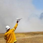 CSIRO's quadcopter UAV examines the experimental grassland burns near Ballarat.