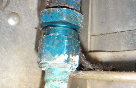 SDR 510021064   Cessna 152 aircraft fuel distribution system—fuel line corroded and leaking. Aluminium fuel line P/No 0400343-3 and union fitting P/No AN815-6D corroded and leaking beneath sleeving insulation P/No S292-18. Suspect corrosion exacerbated by sleeving due to trapping of contamination and moisture. P/No: 04003433. TSN: 10971 hours.
