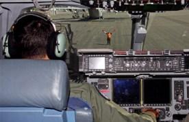 A member of Royal New Zealand Air Force Christchurch Air Movements Terminal marshals in a Royal Australian Air Force No. 36 Squadron C-17 Globemaster