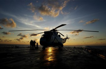 Sea King helicopter on deck (early morning) for preflight checks.