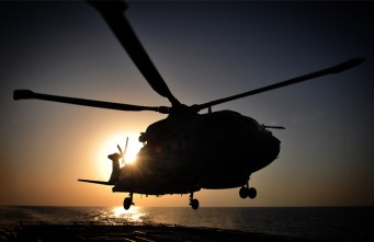 Royal Navy Merlin helicopter lands onboard HMS Somerset near Iraq