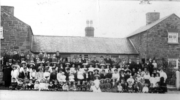 This is, we believe a church outing. Isabella Piercy is seated on the second row from the front and is the 7th from the left. On her knee is baby Griffith dressed in white. This is circa 1897
