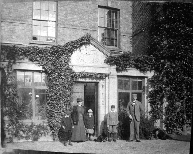 Mr and Mrs Bate with three of their six children outside Kelsterton Hall c.1895. Left to right: Tommy, Perenna, Marjorie, Roger and Thomas Senior
