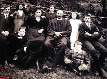 John Bartley seated far left with his family in Cilcain before the war