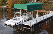 Boat driving into extended canopy lift system.