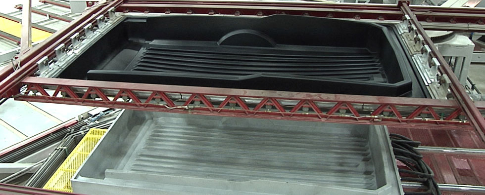 Thermoforming a CargoMax trailer body.