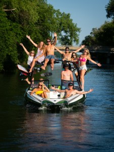 Varatti group photo with passengers sitting up on the wake board tower.