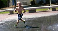Donovan running through the fountain