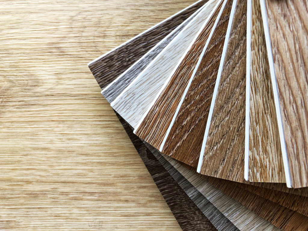 comparing tile vs wood floors for your