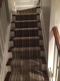A custom staircase with runner by Floors Direct North