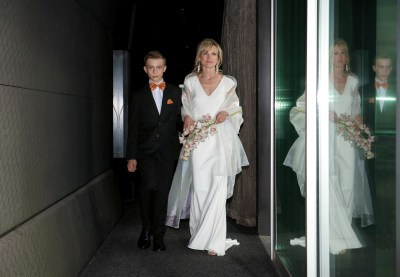 Cristina being escorted by her handsome son.