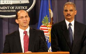 Deputy FBI Director Sean Joyce, left, with Attorney General Eric Holder