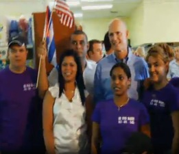 A Rick Scott television ad features the governor shoulder to shoulder with flag-waving smuggler Maikel Duarte-Torres