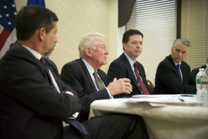 From left to right, Georgetown University professor Bruce Hoffman, former Attorney General Edwin Meese, FBI Director James D. Comey and former Congressman Tim Roemer at a Wednesday press conference