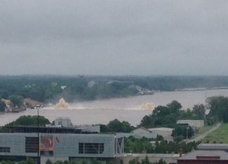 With the Clinton Presidential Center in the foreground, this photo shows a Spectra Energy pipeline blowout beneath the Arkansas River in Little Rock on May 31. Photo Courtesy: Tony Cassady