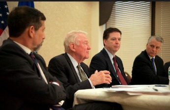 FBI Director James Comey, second from right, is flanked by 9/11 Review Commissioners Tim Roemer, right, Ed Meese and Bruce Hoffman, far left. Photo: FBI