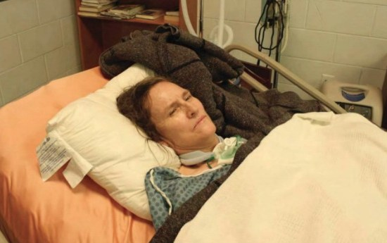 a woman lying in hospital bed on a pillow with a neck brace
