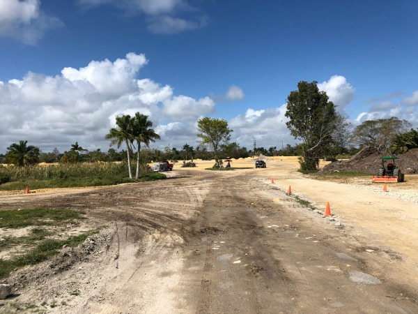 Blue sky and some white clouds above Hollywood's ex-Sunset Golf Course where yellowish lime sludge clean fill is being mixed into the soil to mitigate arsenic on site