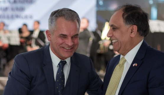 Ex-U.S. Ambassador Asif Chaudry, wearing a gold tie, greets oligarch and fugitive Vladimir Plahotniuc in 2018.